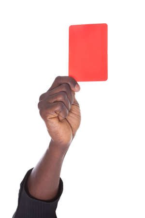 Close-up Of Person's Showing Red Card On White Background photo