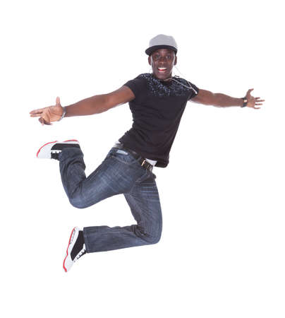 Happy African Young Man Dancing Over White Background photo
