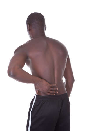 Shirtless African Young Man Suffering From Back Pain photo