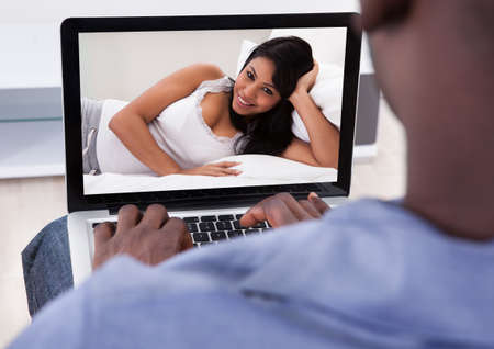 Close-up Of Person Having Video Chat With Woman On Laptop photo