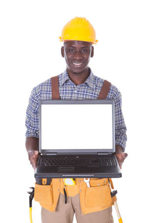 Young Repairman Holding Laptop Over White Background photo