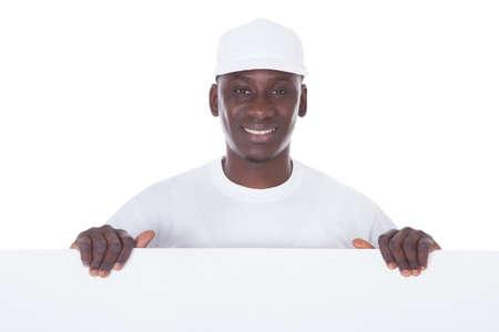 black business men: Portrait Of Male Painter Holding Blank White Banner Over White Background
