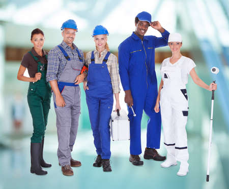 Group Of Multiracial People With Diverse Professions Standing Together Stock Photo