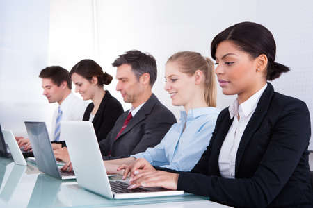Happy Businesspeople In A Row Working Together At Office photo