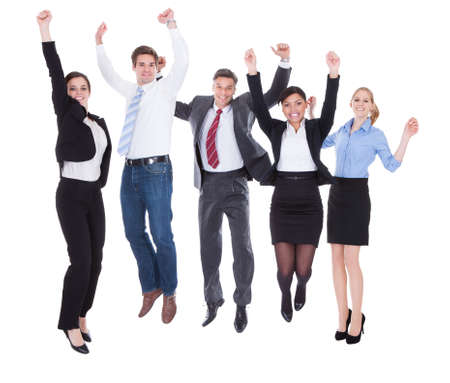 Happy Group Of Businesspeople Raising Hands Over White  photo