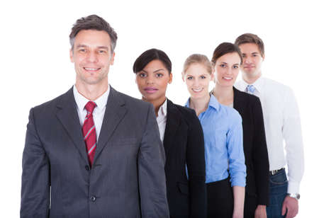 Group Of Businesspeople Standing In A Row Over White  photo