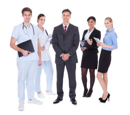 Happy Group Of Businesspeople And Doctors Standing Over White Background photo