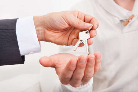 Estate Agent Giving House Keys To Person photo