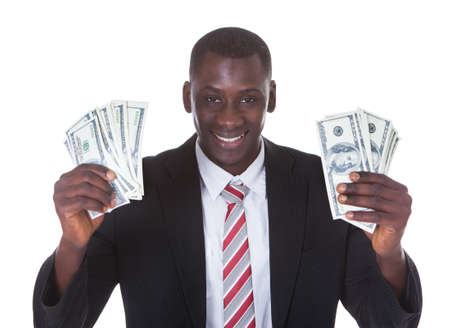 Portrait Of Young Businessman Holding Banknotes Over White Background Banco de Imagens