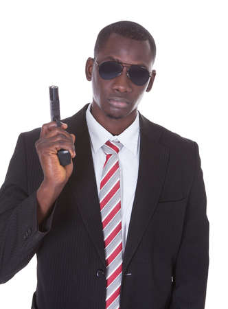 Portrait Of Young Handsome Man With Black Sunglasses And Gun Stock Photo - 25155750