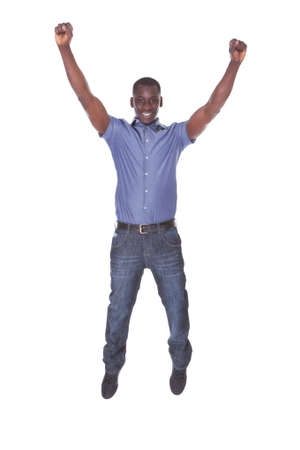 Portrait Of An African Excited Young Man On White  photo