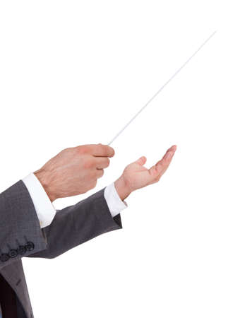 conductors: Close-up Of A Person Directing With A Conductors Baton On Blue