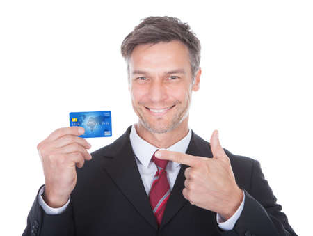 Close-up Of A Smiling Mature Businessman Holding Credit Card photo