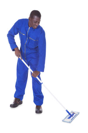 boiler suit: Young Man In Blue Boiler Suit Holding Mop Over White