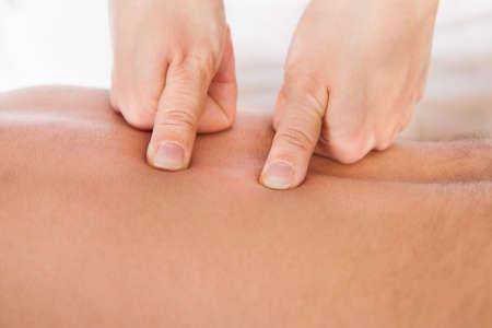 shiatsu: Close-up Of Person Receiving Shiatsu Treatment From Massager