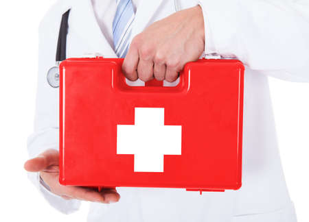 Close-up Of Young Male Doctor Holding Red First Aid Box photo