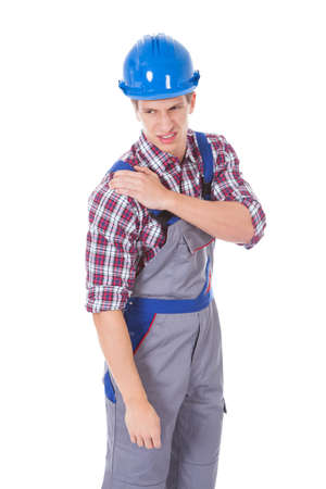 Portrait Of A Worker With Shoulder Pain Isolated On White Background photo