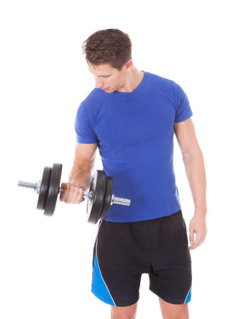 Young Man Exercising With Dumbbells Over White  photo