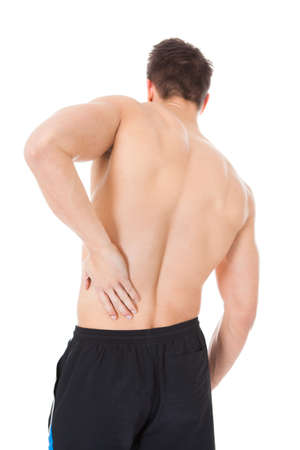 men   back: Portrait Of A Young Man Suffering From Back Pain