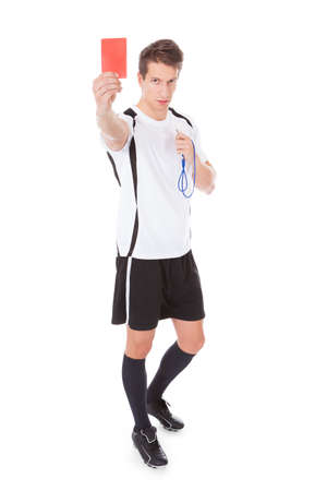 Young Soccer Referee Showing Red Card On White  photo