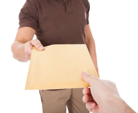 Close-up Of Mailman Delivering Mail To Person Over White  Stock Photo