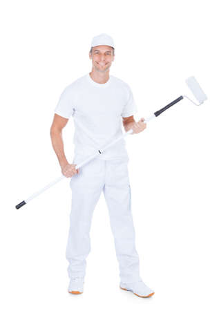 Painter Holding Paint Roller On White Background photo