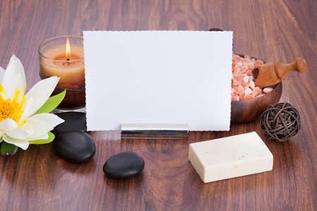 votive: High Angle View Of Blank Paper Surrounded With Spa Products On Wooden Table Stock Photo