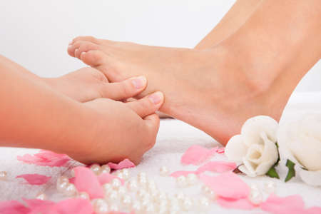 Close-up Of Woman's Feet Receiving Foot Massage In Spa photo