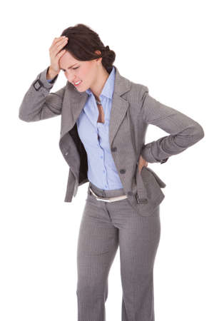 suffer: Portrait Of Young Businesswoman Suffering From Back Pain Over White