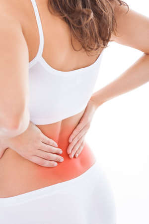 Young Woman With Pain In Her Back Over White
