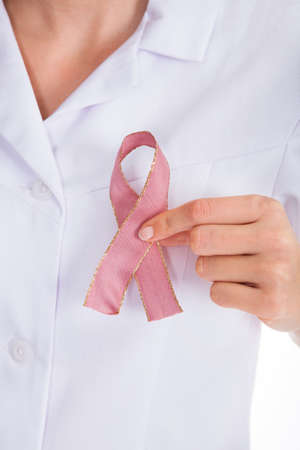 Close-up Of A Doctor Holding Ribbon Formed Aids Symbol photo