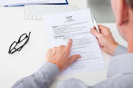 Close-up Of Person Hand Holding Curriculum Vitae