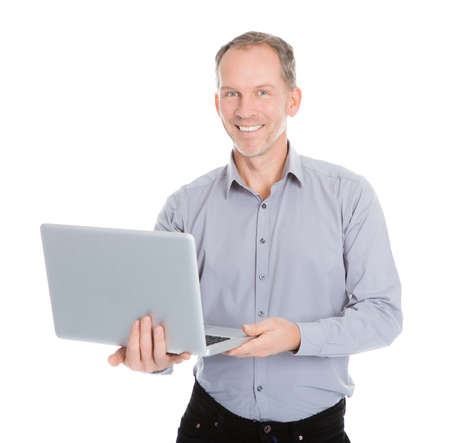 Portrait Of Happy Businessman Holding Laptop Isolated On White Background photo