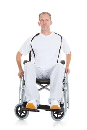 Portrait Of A Mature Man Sitting On Wheelchair photo