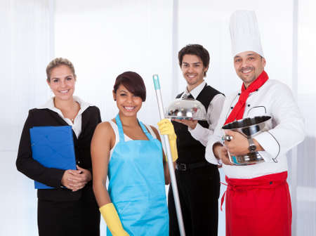 catering service: Four People Of Different Occupations Standing Together