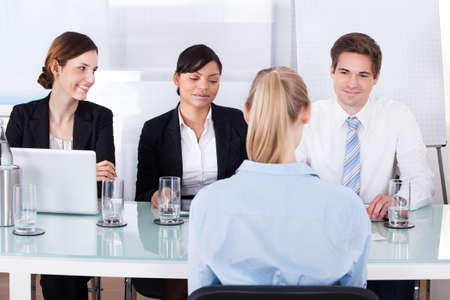 Group Of Businesspeople In Meeting At Conference Table photo