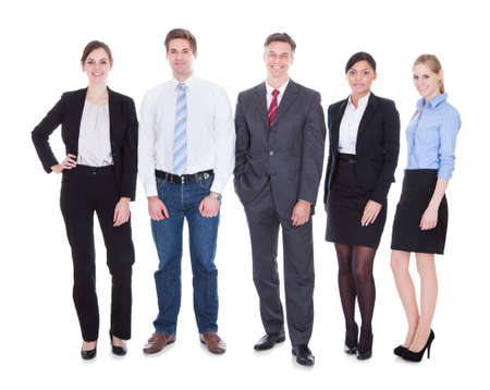 Group Of Happy Business People Standing In Pose Over White Background photo