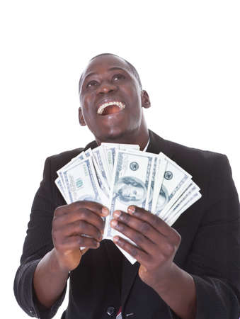american banker: Young African Businessman Holding Banknote Looking Up