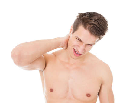 Portrait Of Young Man Suffering From Neck Pain Over White Background photo