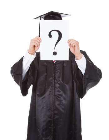 careerist: Graduate Person Holding Question Mark Sign In Front Of Face Over White Background Stock Photo