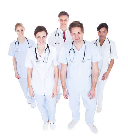 Group Of Happy Doctors Looking Up Over White Background Stock Photo - 25339947