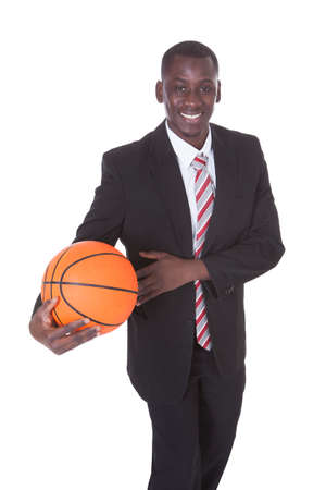 Portrait Of Young African Businessman Playing Basketball photo