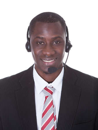 Young African Businessman Wearing Headset Isolated Over White Background photo