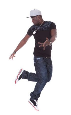 hip hop dance: Portrait Of An African Young Man Dancing Over White Background