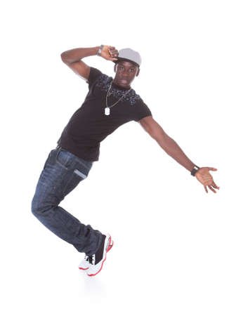 entertainers: Happy African Young Man Dancing Over White Background