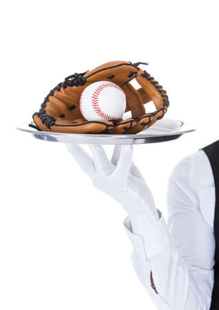 catchers mitt: Close-up Of A Waiter Carrying Baseball And Catchers Mitt In Tray