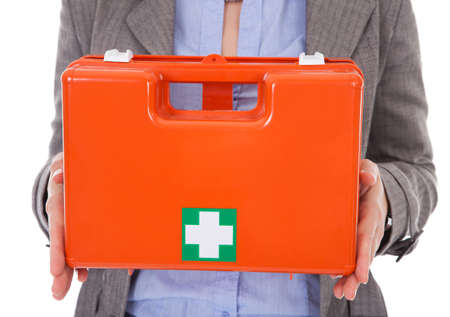 Businesswoman Holding First Aid Box Over White Background photo