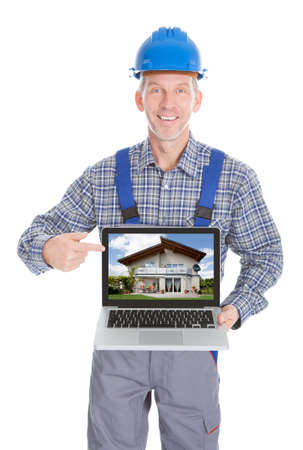 Architect Showing Picture Of Home On Laptop Over White Background photo