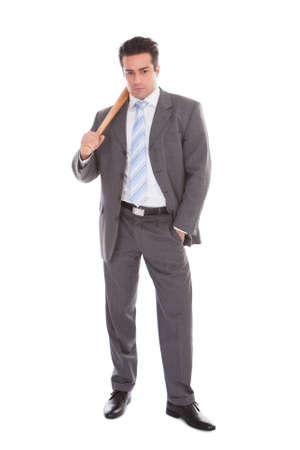 Portrait Of Young Businessman Holding Baseball Bat Over White Background photo