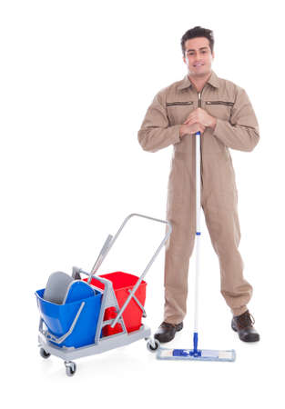Young Male Sweeper Cleaning Floor On White Background photo